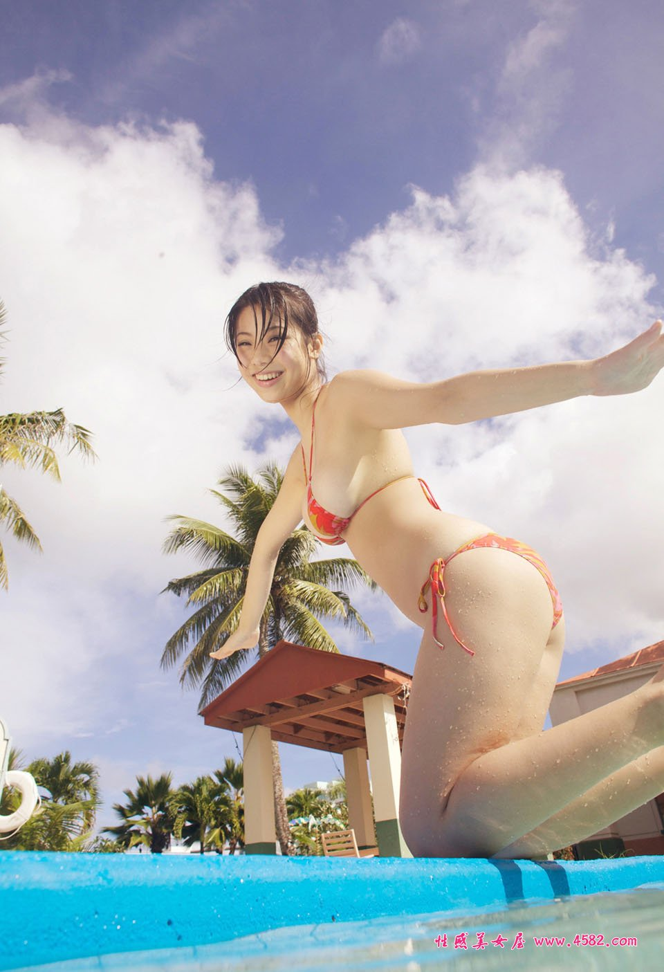 Pretty Chinese lady in swimming pool with XL big size page